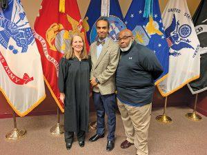 Judge Halee Weinstein with Veterans Court Graduate Eric Brown and mentor Tyrone Bonds